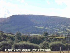 View from meadow towards black mountains