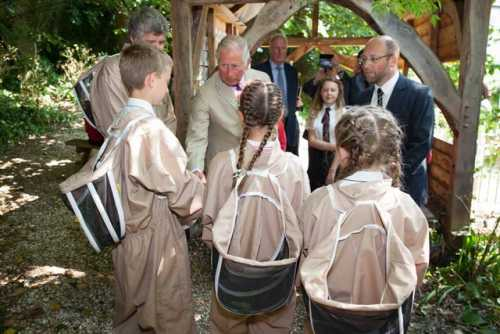 HRH, Prince Charles talking with the children.